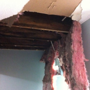 Damage caused by a roof leak