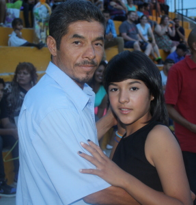 Miriam and her father dancing at the school graduation