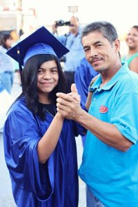 Blanca dancing with her dad at her graduation